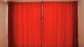 Window with red curtains closed background. Window with red curtains closed in the interior of a room Royalty Free Stock Images