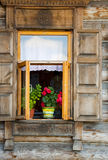 Window and red flowers, Beauty Royalty Free Stock Photography