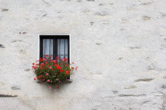 Window with red geranium Royalty Free Stock Photo