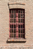 Window with red gratings royalty free stock photo