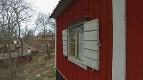 Window On Red House. White window on the red house at Stockholm Skansen, Sweden during cloudy day stock footage