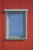Window and red lines. One window from outside with red wall royalty free stock photography