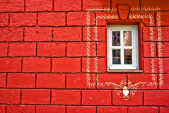 Window on a red wall. Most of conspicuous things in life is red Stock Image