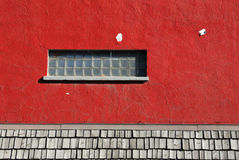 Window on red wall Royalty Free Stock Image