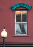 Window in Red. A well-dressed window on one of the historic buildings in downtown Wilmington catches the eye Stock Images