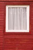 Window in a red, wooden wall Royalty Free Stock Images