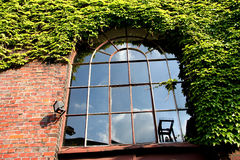 Window with Reflection. Reflection of an old coal mine tower Royalty Free Stock Image