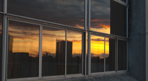 Window reflection of Coventry's city scape during sunset Stock Photos