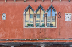 Window reflection on the historic building of Venice Stock Images