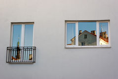 Window reflections. Old Tallinn houses reflecting in new windows Stock Photos