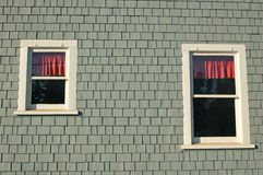 Window reflections. A wall with some windows Royalty Free Stock Photos