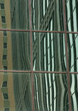 Window Reflections. Reflections of building distorted by Window Royalty Free Stock Photography
