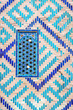 Window at Registan mausoleum, Samarkand, Uzbekistan. Window on a wall of blue tiles and mosaic of Registan mausoleum, Samarkand, Uzbekistan Stock Photos