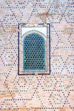 Window at Registan mausoleum, Samarkand, Uzbekistan. Window on a wall of blue tiles and mosaic of Registan mausoleum, Samarkand, Uzbekistan Royalty Free Stock Photo