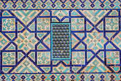 Window at Registan mausoleum, Samarkand, Uzbekistan. Window on a wall of blue tiles and mosaic of Registan mausoleum, Samarkand, Uzbekistan Royalty Free Stock Photography