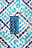 Window at Registan mausoleum, Samarkand, Uzbekistan. Window on a wall of blue tiles and mosaic of Registan mausoleum, Samarkand, Uzbekistan Stock Image