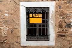 A window with a For Rent sign in the old town of Caceres. A window with a For Rent sign in the old town of Caceres, Extremadura, Spain stock image