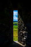 Window at Rock of Cashel with View to Castle and Landscape in Ireland Royalty Free Stock Photography