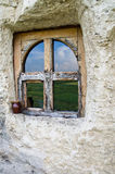 Window in the Rock. Window cut into the stone reflecting the valley Royalty Free Stock Photo