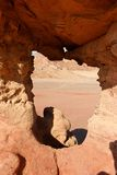 Window in the rock in desert Stock Photography