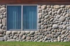 Window in Rock Wall. A dual pane window with aluminum frame in a rock wall Royalty Free Stock Images