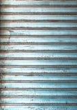 Window roller blinds. Grungy light blue metal window roller blinds background Stock Photo