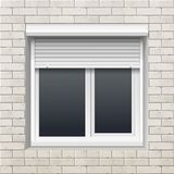 Window with Rolling Shutters on a Brick Wall Stock Photography