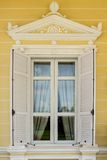 Window. The Roman style white window on yellow wall Royalty Free Stock Photography