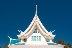 Window in a roof  against blue sky with triangle shape in Thaila Royalty Free Stock Photos