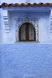 Window with roof on blue house Stock Photography