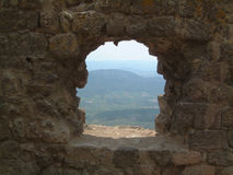 Window on Roussillon. View through on a window of Chateau de Queribus, Languedoc, France. An area rich in history and vineyards Royalty Free Stock Images