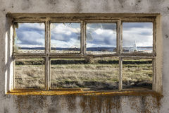 Window of a ruined factory Stock Image