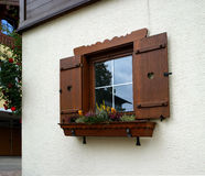 Window of the rural house. With flowers Stock Images