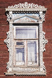 Window Russian house with carved architraves Stock Images