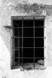 Window with rusted bars. A window with rusted bars in an old house Royalty Free Stock Images