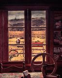 A window`s view from inside an old house. stock photo