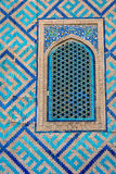 Window at Samarkand Registan, Uzbekistan. Detail of window on the wall with blue tiles pattern of Samarkand Registan, Uzbekistan Royalty Free Stock Images