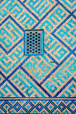 Window at Samarkand Registan, Uzbekistan. Detail of window on the wall with blue tiles pattern of Samarkand Registan, Uzbekistan Royalty Free Stock Photography