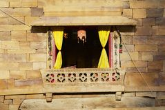 Window in the sandstone wall of the fort in Jaisalmer, India. royalty free stock images