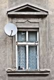 Window and satellite dish Stock Photo