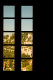 Window scenic. View from a window in a dark room Royalty Free Stock Images