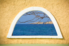 Window. Sea view through the window arc. Architectural detail of the Greek islands Royalty Free Stock Photo