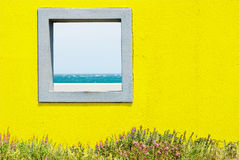 Window and seascape. Yellow window in the garden with seascape Stock Photos