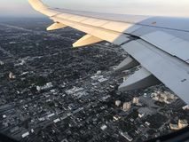 Window seat View. A view of the wing as I fly to Stock Photo