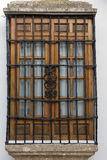 Window security bars. Lattice style security bars on a wooden wooden window Royalty Free Stock Image