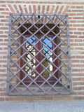 Window with security bars. Wrought Iron Grill or bars on Window in central madrid, spain Stock Photography