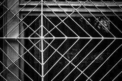 Window security frame constructed from metal resembles a spider web in compos Stock Photos