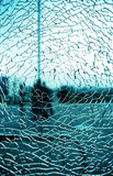 Broken glass window. A window that is shattered with a green-blue background Royalty Free Stock Photo