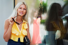Happy blond fashion woman shopping in the mall Stock Photos