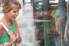 Window shopping. Pretty blond girl windowshopping Royalty Free Stock Images